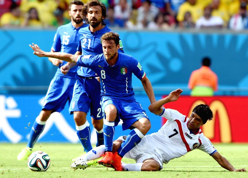 Costa Rica's Christian Bolanos (R, front) slide tackles the ball controlled by Italy's Claudio Marchisio (L, front) during a Group D match between Italy and Costa Rica .