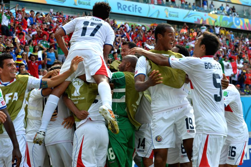 Costa Rica's players celebrate for Bryan Ruiz's goal during a Group D match between Italy and Costa Rica of 2014 FIFA World Cup at the Arena Pernambuco Stadium in ...