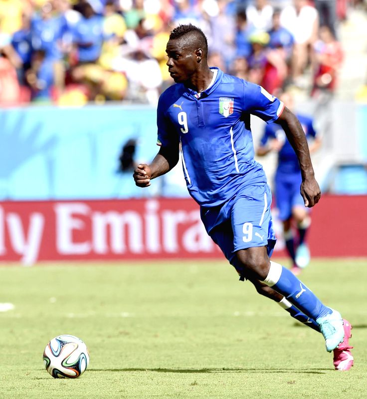 Italy's Mario Balotelli controls the ball during a Group D match between Italy and Costa Rica of 2014 FIFA World Cup at the Arena Pernambuco Stadium in Recife, Brazil, .