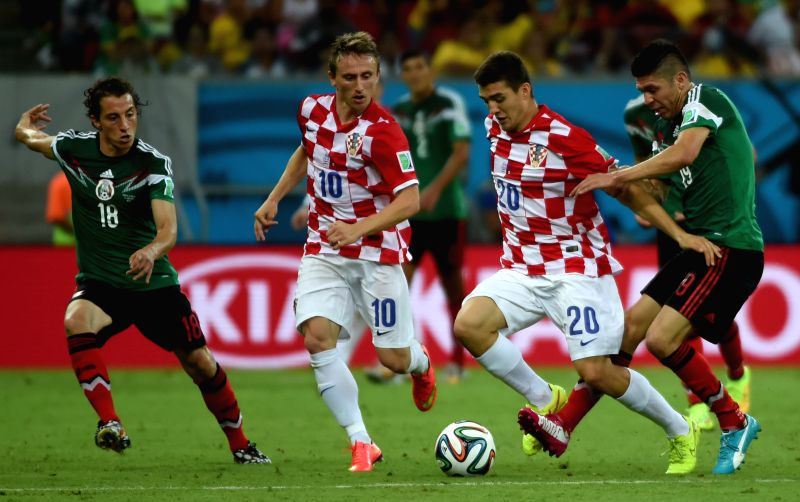 Croatia's Mateo Kovacic (2nd R) runs with the ball during a Group A match between Croatia and Mexico of 2014 FIFA World Cup at the Arena Pernambuco Stadium in ...