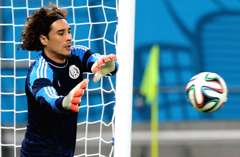 Guillermo Ochoa, goalie of the Mexican national soccer team, takes part in a training session at the Arena Pernambuco, in Recife, Brazil, on June 22, 2014.
