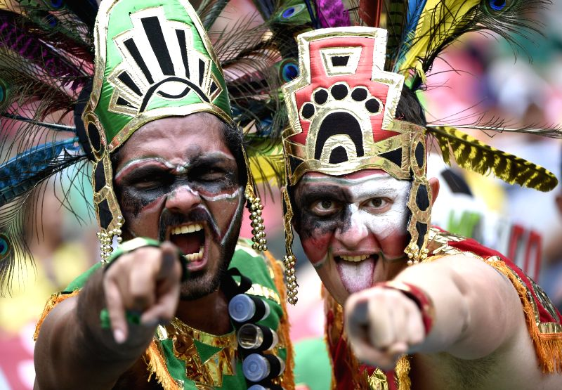 Mexico's fans pose before a Group A match between Croatia and Mexico of 2014 FIFA World Cup at the Arena Pernambuco Stadium in Recife, Brazil, June 23, 2014. ...