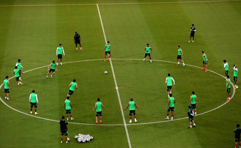 Players of the Mexican national soccer team take part in a training session at the Arena Pernambuco, in Recife, Brazil, on June 22, 2014.