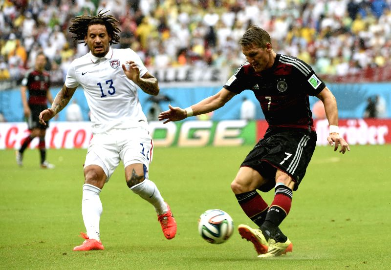 Germany's Bastian Schweinsteiger (R) vies with Jermaine Jones of the U.S. during a Group G match between the U.S. and Germany of 2014 FIFA World Cup at the Arena ...