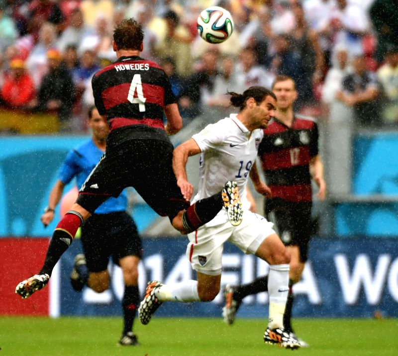 Germany's Benedikt Howedes (L, front) vies with Graham Zusi of the U.S. during a Group G match between the U.S. and Germany of 2014 FIFA World Cup at the Arena ...