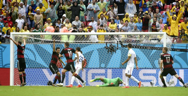 Goalkeeper of the U.S. Tim Howard (bottom) fails to block the shot by Germany's Thomas Muller during a Group G match between the U.S. and Germany of 2014 FIFA World .