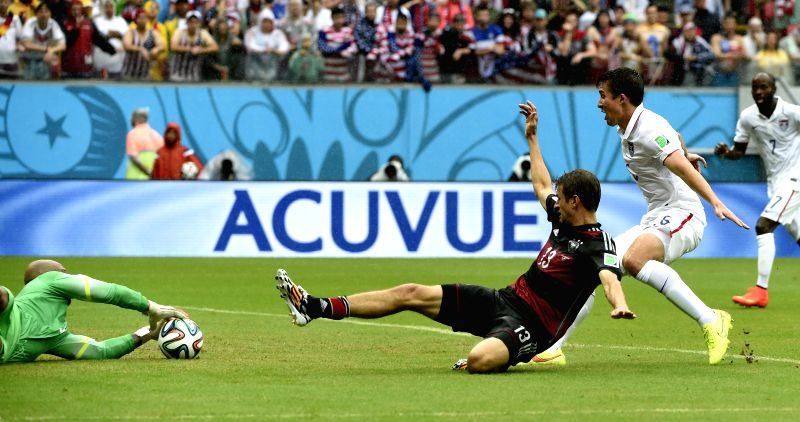 Goalkeeper Tim Howard (1st L) of the U.S. blocks the ball shot by Germany's Thomas Muller (2nd L) during a Group G match between the U.S. and Germany of 2014 FIFA ...