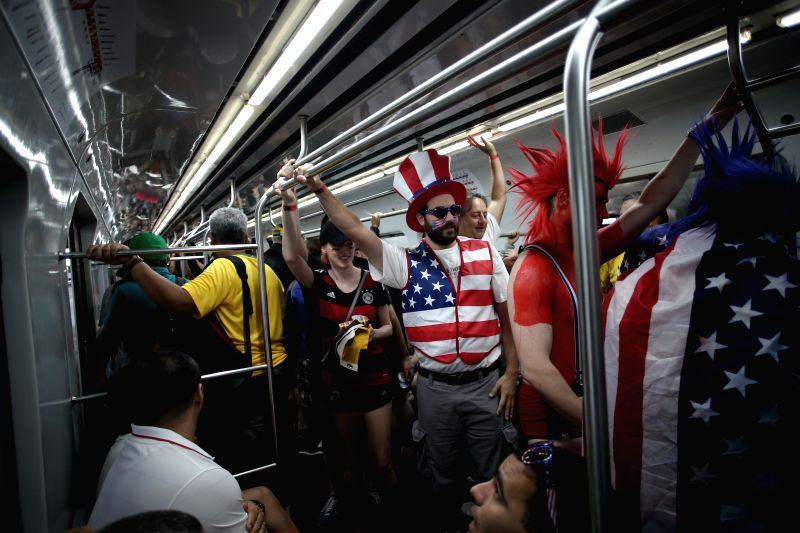Supporters of the U.S. are seen on a train to the Arena Pernambuco Stadium where a Group G match between the U.S. and Germany of 2014 FIFA World Cup is held, in ...