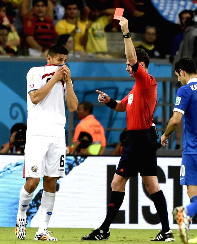 Australia's referee Benjamin Williams (C) shows a red card to Costa Rica's Oscar Duarte during a Round of 16 match between Costa Rica and Greece of 2014 FIFA World ..