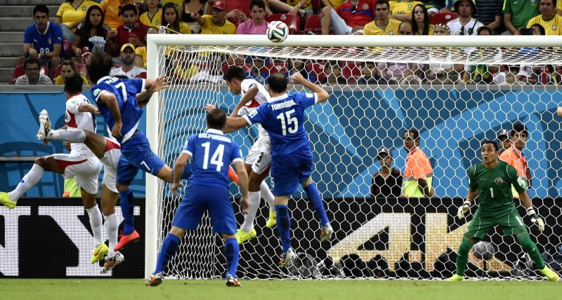 Costa Rica's goalkeeper Keilor Navas (1st R) defends during a Round of 16 match between Costa Rica and Greece of 2014 FIFA World Cup at the Arena Pernambuco Stadium .