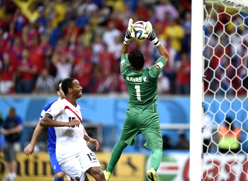 Costa Rica's goalkeeper Keilor Navas (R) blocks the ball during a Round of 16 match between Costa Rica and Greece of 2014 FIFA World Cup at the Arena Pernambuco ...