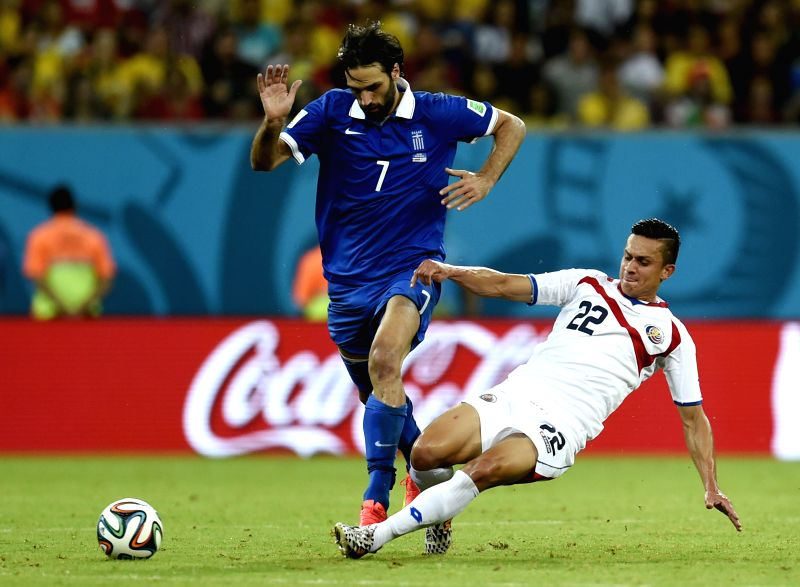 Costa Rica's Jose Miguel Cubero (R) vies with Greece's Giorgios Samaras during a Round of 16 match between Costa Rica and Greece of 2014 FIFA World Cup at the Arena .