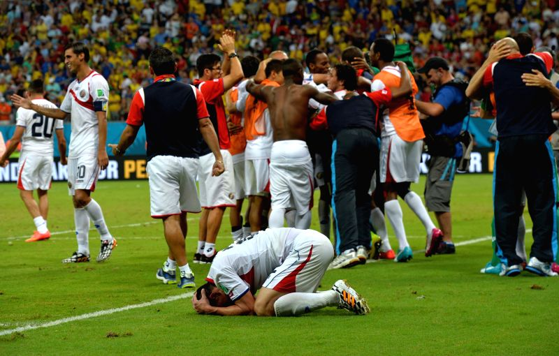 Costa Rica's players celebrate their victory after the penalty shoot-out of a Round of 16 match between Costa Rica and Greece of 2014 FIFA World Cup at the Arena ...