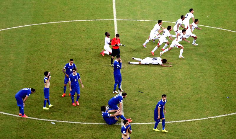 Costa Rica's players and Greece's player react after the penalty shoot-out of a Round of 16 match between Costa Rica and Greece of 2014 FIFA World Cup at the Arena ..