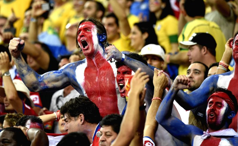 Supporters of Costa Rica cheer before a Round of 16 match between Costa Rica and Greece of 2014 FIFA World Cup at the Arena Pernambuco Stadium in Recife, Brazil, on .