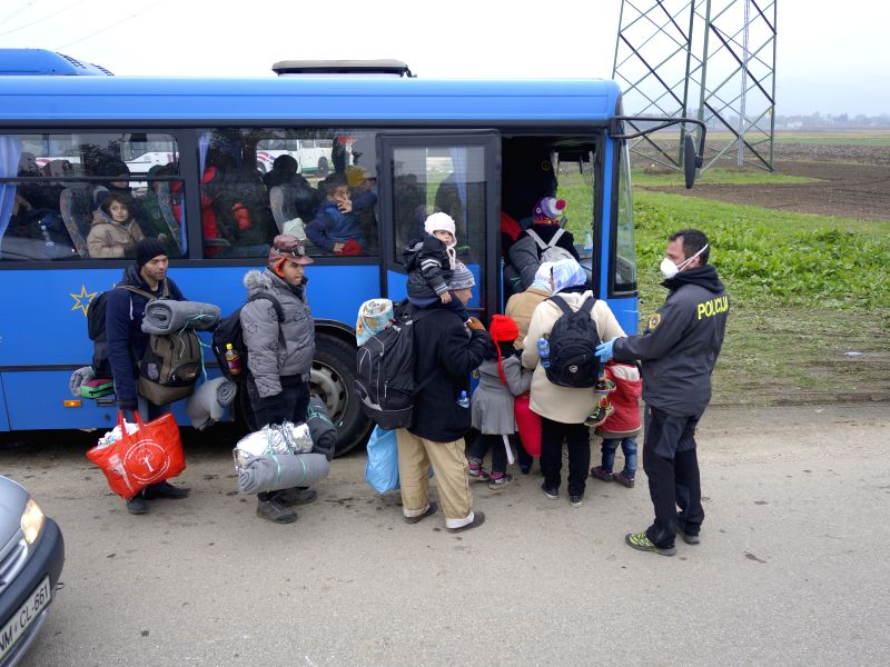 Refugees coming from Croatia by train queue to get on buses to be transfered to the refugee centre inland Slovenia in Rigonce, a tiny Slovenian border town with ...