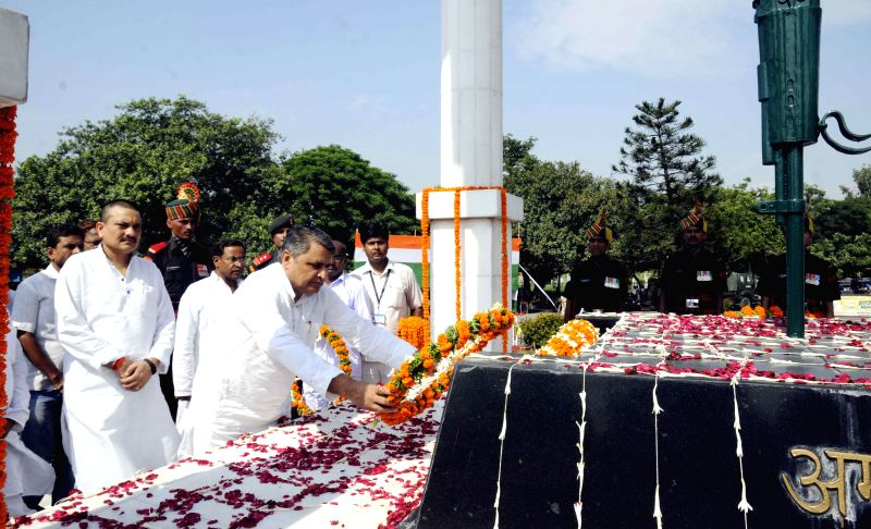 Relatives of soldiers paying tribute to martyrs on the occasion of Kargil Vijay Diwas at Kargil Chowk in Patna on July 26, 2014.