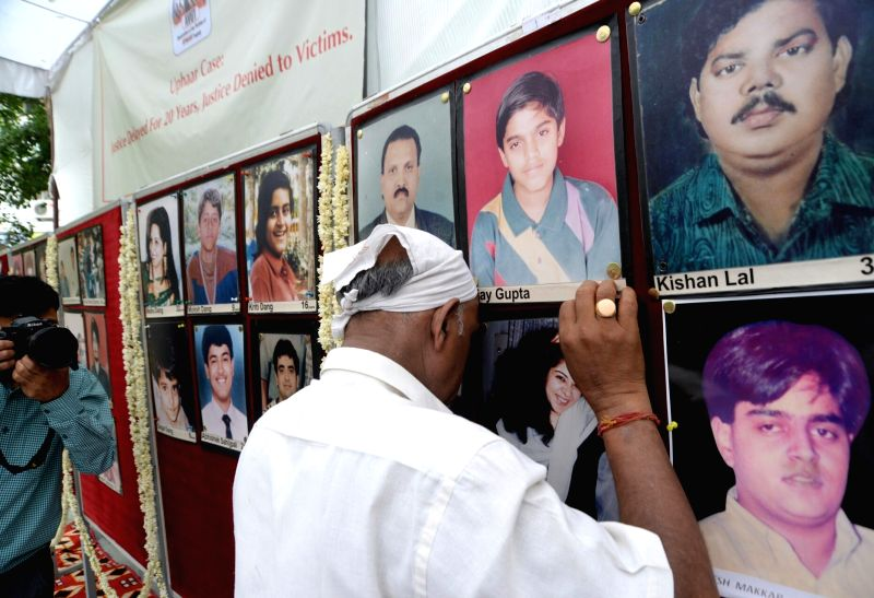 Relatives of Uphaar Cinema fire victims during a programme organised to pay tribute to them on the 20th anniversary of the accident in New Delhi, on June 13, 2016.