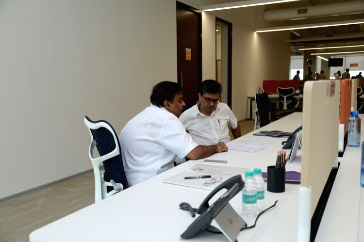 Reliance Industries Ltd (RIL) Chairman Mukesh Ambani interacts with close associate Manoj Modi at Reliance Jio`s `open office` in Mumbai on Nov. 4, 2015.  The open office, which houses 70 of Jio`s ... - Mukesh Ambani and Manoj Modi