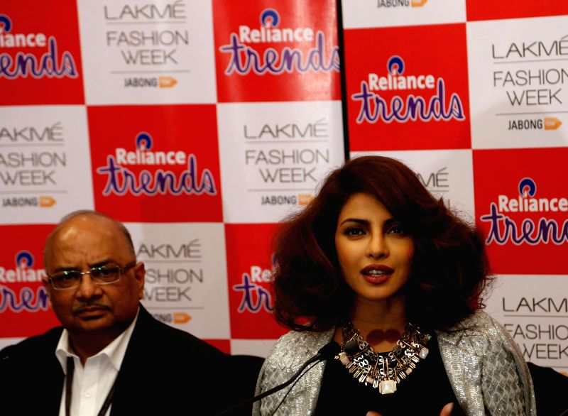 Reliance Trends CEO, Akhilesh Prasad and actress Priyanka Chopra at the Lakme Fashion Week in Mumbai.
