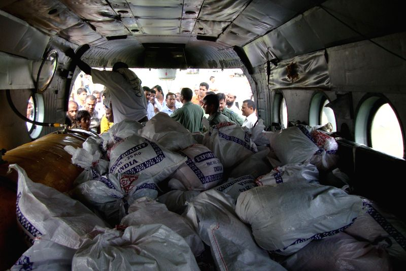 Relief Materials in a MI 17 Helicopter to be dropped in flood hit areas of Bahraich and Nanpara in Uttar Pradesh, at Bakshi-Ka Talab, near Lucknow on Aug 18, 2014. 7400 Kg of food supplies and ...