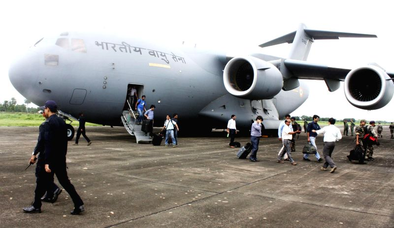 Relief team deboards C-17 Globemaster III Heavy Lift Transport Aircraft, at Air Force Station Purnea, in Bihar on August 04, 2014. The aircraft was used to airlift relief equipments (Rapid Action ...
