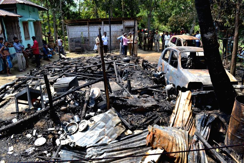 Remains of the houses and vehicles belonging to Congress supporters which were allegedly torched by Communist Party of India-Marxist (CPI-M) supporters in Echwipur village under Dharmanagar ...