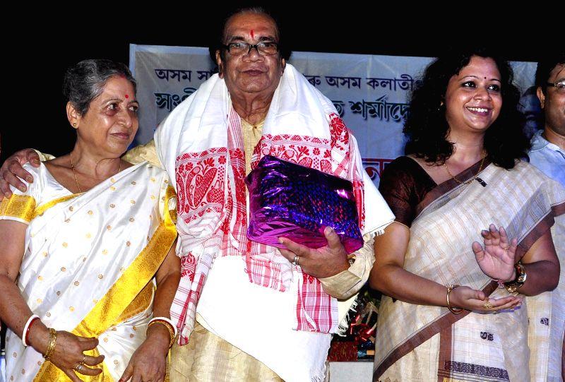 Renowned flutist Prabhat Sharma being felicitated by Asom Sahitya Sabha and Asom Kalatirtha on his birth day in Guwahati on July 6, 2014.