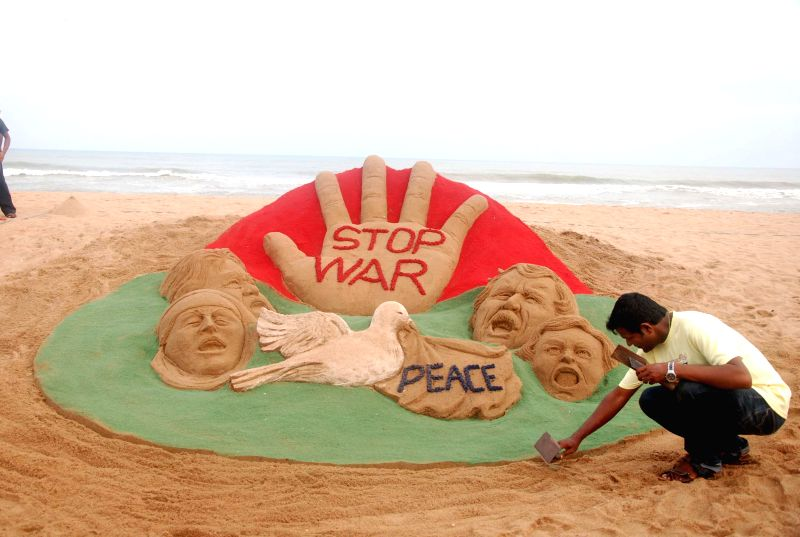 Renowned sand artist Sudarsan Pattnaik condemns state of discord between Israel and Palestine through his art on Puri beach in Odisha on July 25, 2014.
