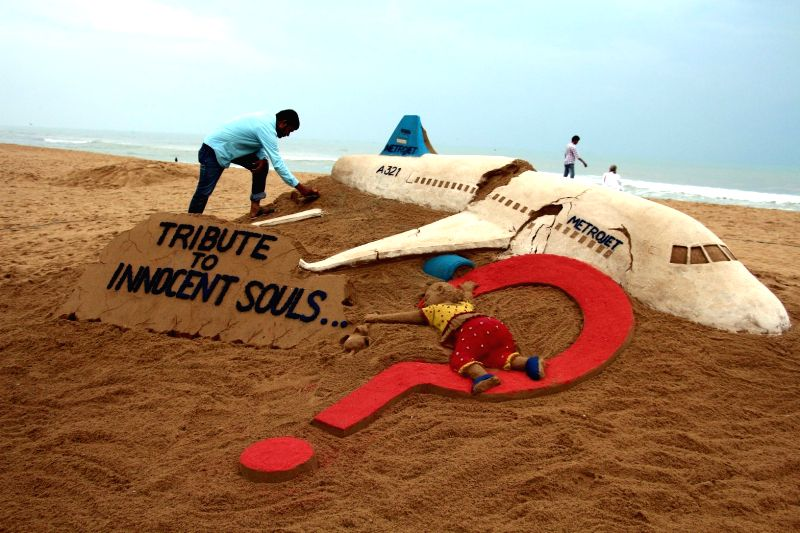 Renowned sand artist Sudarsan Pattnaik pays tribute to the passengers of St. Petersburg bound Russian airliner that crashed in Egypt's Sinai peninsula; at Puri beach, Odisha on Nov 1, 2015.