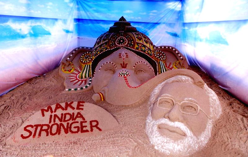 "Renowned sand artist Sudarsan Pattnaik's creation which depicts that lord Ganesha blesses Prime Minister Narendra Modi to ""make India stronger"" ahead of Ganesh Chaturthi at Alkapuri Ganesh . - Narendra Modi"