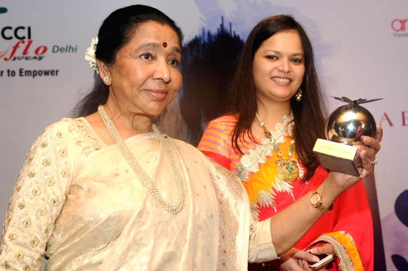 Renowned singer Asha Bhonsle during `Asha Ji - a brimful of magic` a programme organised by Young FICCI Ladies Organisation in New Delhi on July 14, 2014.
