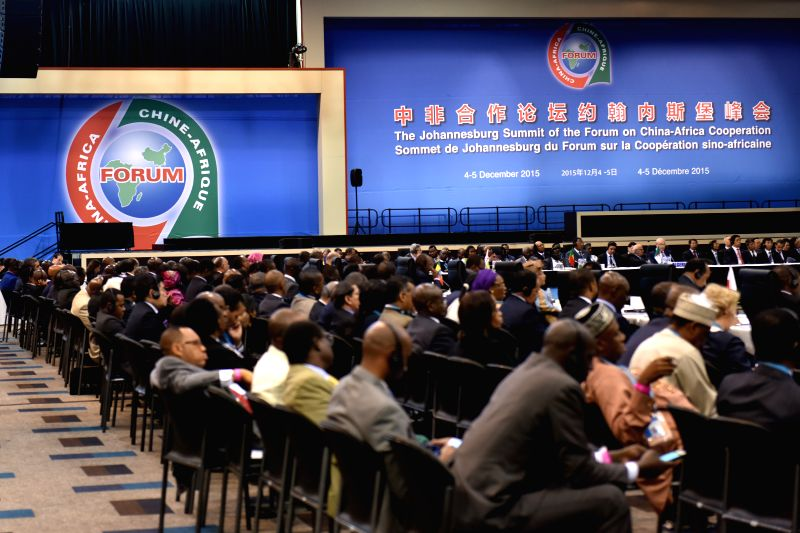 Representatives attend the closing ceremony of the Johannesburg summit of the Forum on China-Africa Cooperation (FOCAC) in Johannesburg, South Africa, Dec. 5, ...
