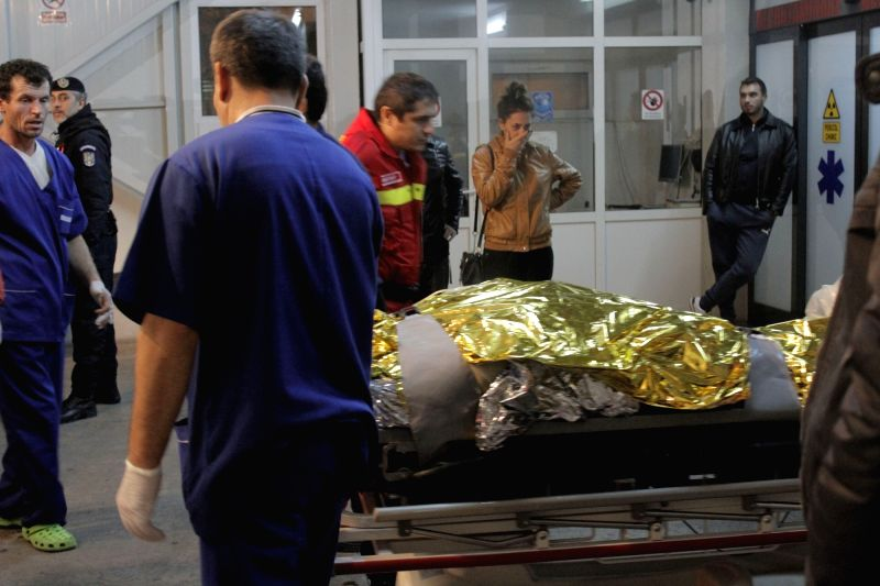 Rescue members transfer an injured person to a hospital in Bucharest, capital city of Romania, Oct. 31, 2015. The nightclub fire late Friday followed by ...