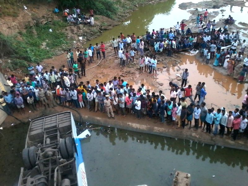 Rescue operation underway at the site where a private travel company bus plunged into a canal at Nayakangudem in Telangana on Aug 22, 2016. Reportedly 10 people were killed and 18 ...