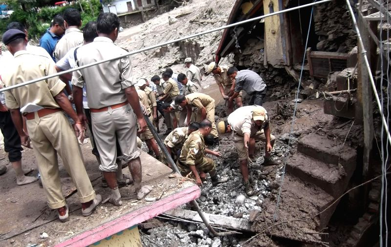 Rescue operations underway after a cloudburst hit Netad village in Tehri district on July 31, 2014.