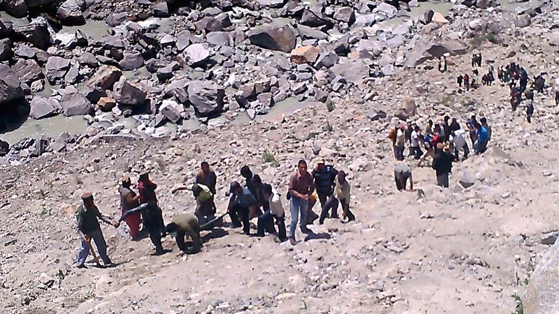 Rescue operations underway after an overcrowded mini bus skidded off the road and fell into the Baspa river, some 300 feet below the road killing at least 23 and injuring 20 others, near Sangla of ...