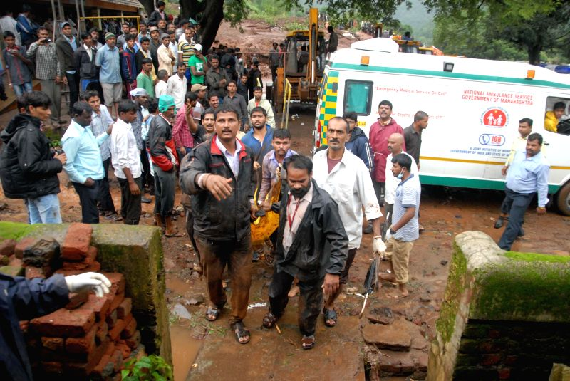 Rescue operations underway at Malin village, near Pune which was buried in a landslide, killing at least 25 people and trapping more than 160 early morning on July 30, 2014. A 300-strong team, ...