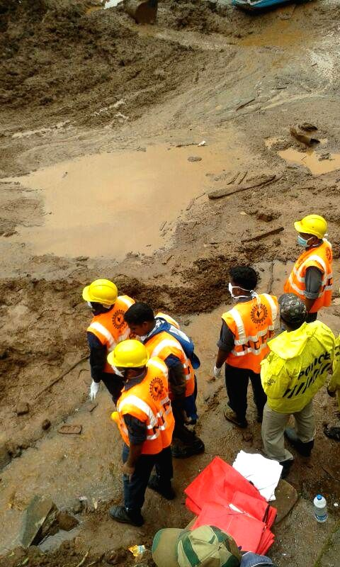 Rescue operations underway at Malin village, near Pune which was buried in a landslide, killing at least 65 people on early Wednesday (30th July, 2014) morning; on August 1, 2014. A 300-strong team, .