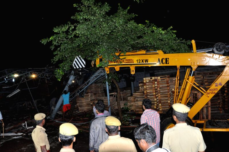 Rescue operations underway at the site where a portion of a 11-storey under construction building at Moulivakkam in Chennai collapsed on June 28, 2014.