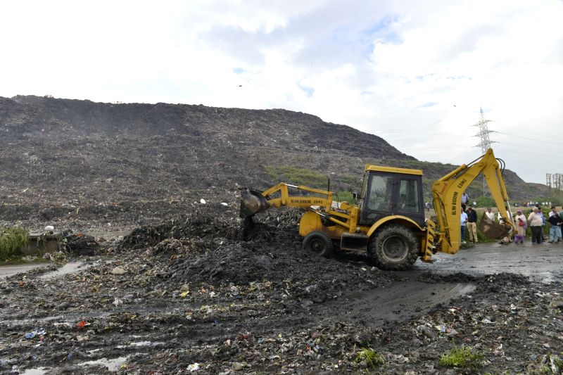 :Rescue operations underway at the site where a huge part of a landfill collapsed in east Delhi's Ghazipur on Sept 1, 2017. (Photo: IANS).