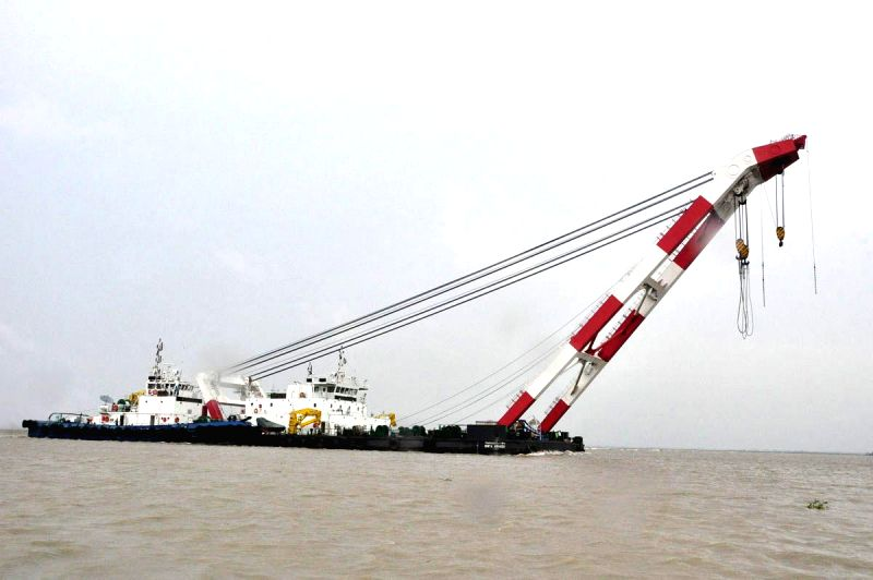 Rescue personnel involved in rescue operations after Pinak-6 - a launch capsized  in Padma river near Mawa, Bangladesh on Monday (4th Aug, 2014); on Aug 5, 2014. The launch had 200 passengers ...
