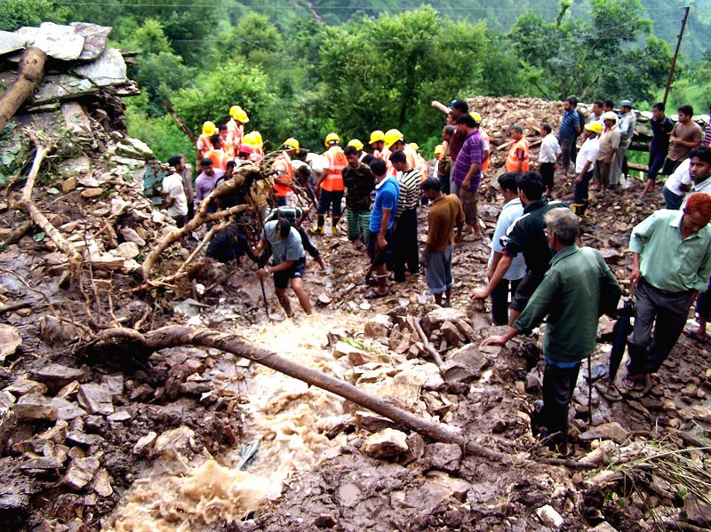 Rescue work in progress at a cloud burst site in Pauri district on Aug. 16, 2014.