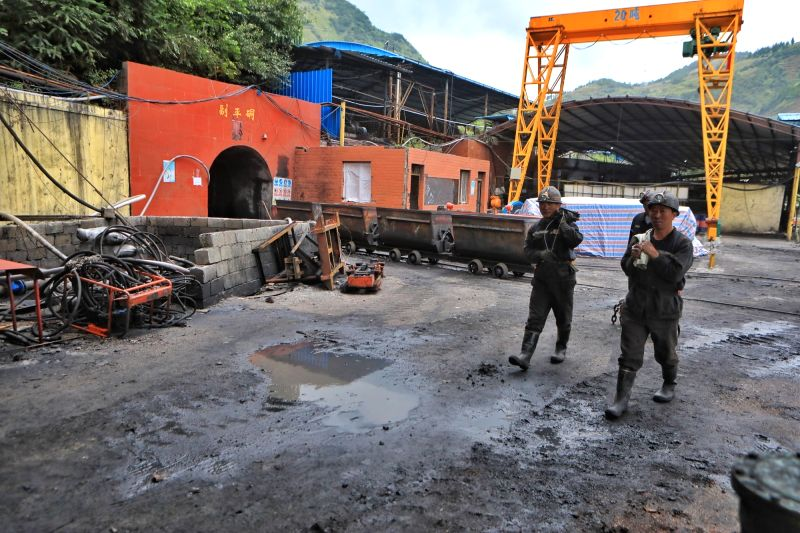 : Rescuers are seen at the accident site after a coal and gas outburst happened at Zimujia coal mine in Panzhou City, southwest China's Guizhou Province, Aug. ...