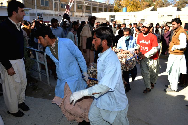 Rescuers transfer an injured man to a hospital in Quetta, southwest Pakistan, Nov. 17, 2015. At least 13 people were killed and over 100 others injured when four ...