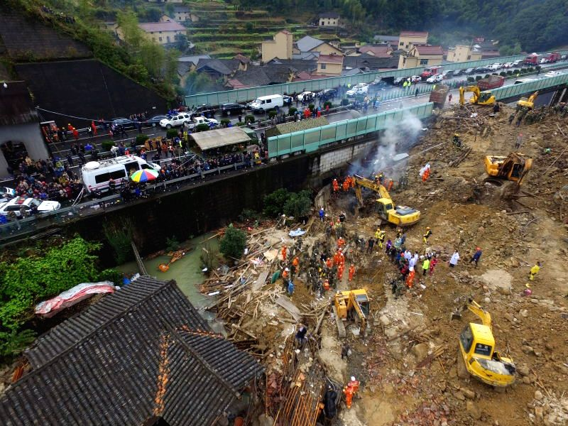 Rescuers work at the accident site after a landslide hit Lidong Village of Yaxi Township in the outlying Liandu District of Lishui City, east China's Zhejiang ...