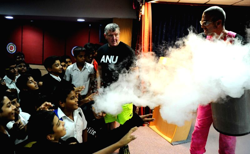 Researchers from Australian National University Dr. Graham Walker and Dr. Stuart Kohlhagen display science experiments at the Visvesvaraya Industrial and Technological Museum in Bengaluru ...