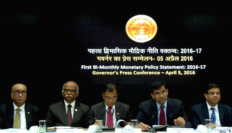 Reserve Bank of India (RBI) Governor Raghuram Rajan during a press conference in Mumbai, on April 5, 2016. Also seen RBI Deputy Governors H R Khan and R Gandhi. - R Gandhi