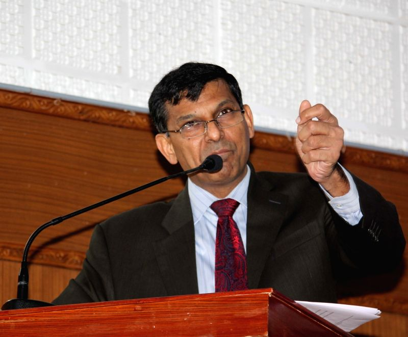 "Reserve Bank of India (RBI) Governor Raghuram Rajan addresses during a seminar on ""Equity Access and inclusion transforming to rural India through Financial inclusion"" in ..."