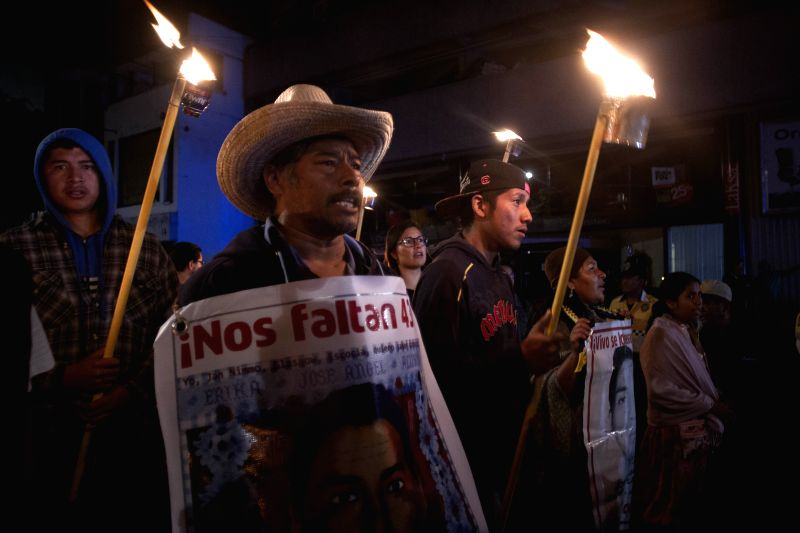 Residents and relatives of the 43 students from the Ayotzinapa Teacher Training College Raul Isidro Burgos hold a protest in Mexico City, capital of Mexico, on ...